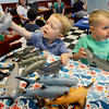 BRYAN EATON/Staff photo. David White, 2, of Newburyport, left, and Kyle Sullivan, 3, of Newbury check out the rubber model sharks in the Children's Room at the Newburyport Public Library on Monday. Family and Community Connection set up the room with sensory learning and early STEM activities with a ocean theme.