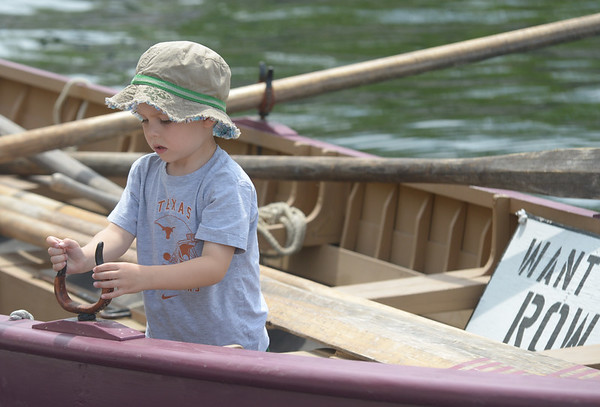 JIM VAIKNORAS/Staff photo Cian McCarthy, 5, of Newburyport checks out a 28 ft whale boat from Lowell's Boat Shopat Touch a Boat on the Newburyport Waterfront Saturday.of Andover takes the wheel of a Coast Guard boat Touch a Boat event along Newburyport's waterfront Saturday. Along with the whaleboat kids got to get up close to a Coast Guard Boat, the Erica Lee II and many others.