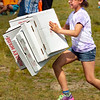 BRYAN EATON/Staff Photo. The pizza boxes get away from Ciera Smith's hands in a relay at Field Days at Salisbury Elementary School on Monday morning. Youngsters started out with three boxes and in each heat the load was increased by one box up to ten.