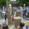 JIM VaIKNORAS/Satff photo Kids dance around the Inn Street fountain at it's dedication Saturday. About 100 people showed up for the event which feature a performance by the Greater Newburyport Youth Chorus. Many of those in attendance, including Mayor Holaday, enjoyed the water.