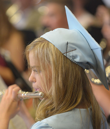 JIM VAIKNORAS/Staff photo Graduate Britaney Miller plays with the band at Triton's Commencement Saturday in the school's field house.