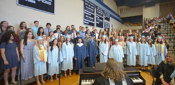 """JIM VAIKNORAS/Staff photo Graduates join the Triton High School Singer in Carole King's """"You've Got a Friend"""" at Triton's Commencement Saturday in the school's field house."""