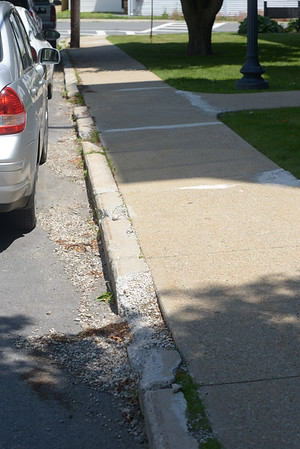 JIM VAIKNORAS/Staff photo 6/24/2016 Sidewalk on Charles Street in Newburyport to be repaired.