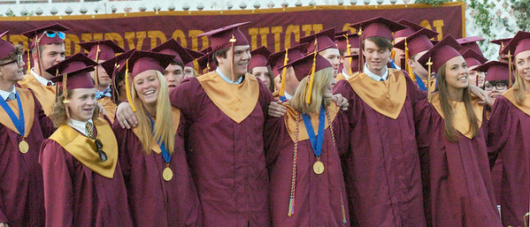 "BRYAN EATON/Staff Photo. Newburyport High graduates sing ""Alma Mater."""