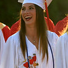 JIM VAIKNORAS/Staff photo Isabel Prussman is all smiles as she marches into Landry Stadium at the start of Amesbury high graduation Friday night.