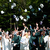 JIM VAIKNORAS/Staff photo Pentucket graduates toss their caps after commencement Saturday in West Newbury.