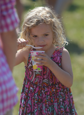 JIM VAIKNORAS/Staff photo  Lexie Ponikuar, 4, enjoys an Italian Ice at the Rowley 4th of July festival at Rowley Common Saturday morning.