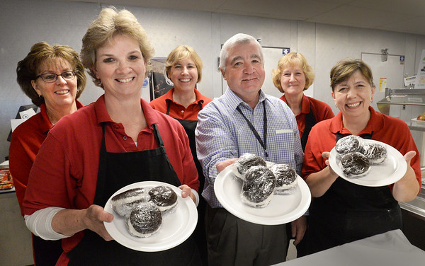 BRYAN EATON/Staff Photo. The kitchen crew at Amesbury High School raised $1,000 selling whoopie pies to benefit Our Neighbor's Table. From left, Karen Clark, Jeanne Sheehan, Michele Pouliot, Kevin Kish of Chartwell, Gail Moulton and Rhonda Gallagher.