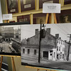 BRYAN EATON/Staff Photo. A display of over a dozen old photos of Inn Street are in the hallway at Newburyport City Hall. The one at left, circa 1940, looks up Inn Street with Oregano's Restaurant at the lower right. The photo at right, in the early 1960's looks down Inn Street where the Elephant's Truck is now at left.