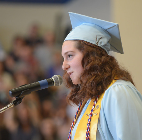 JIM VAIKNORAS/Staff photo Honor speaker salutatorian Marianna Odoy gives her address at Triton's Commencement Saturday in the school's field house.