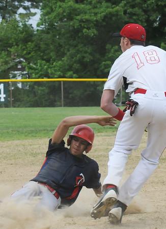 BRYAN EATON/Staff Photo. Amesbury third baseman Incontri waits for the throw as a Charlestown player is safe.