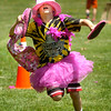 BRYAN EATON/Staff Photo. Owen Kreuz, 10, competes in the Pretty in Pink relay at the Molin Upper Elementary School in Newburyport Tuesday afternoon. They were having their Survivor Day with all kinds of fun, competitive activites for the annul year end event.