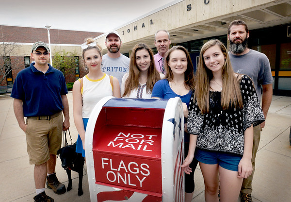 BRYAN EATON/Staff photo. Triton High School students decorated an old mailbox donated by the U.S. Postal Service as a drop off for old American Flags to be disposed of properly. The students, front, from left, Lydia Crowley, Leandra Drouin, Kathryn Eaton and Mackenna Faucher, all 15. Back from left, Don Jarvis, who spearheaded the project; teacher Joshua Andrews; Newburyport postmaster Paul E. Bolas and Newbury selectman Damon Jespersen.