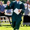 JIM VAIKNORAS/Staff photo John Reinhold waves to his classmates after getting his diploma at Pentucket's graduation Saturday.