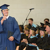JIM VAIKNORAS/Staff photo Shane D'Arcy gives the thumb's up at Triton's Commencement Saturday in the school's field house.