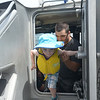 JIM VAIKNORAS/Staff photo Brennan Fuoco, 3,of Salem NH and his Dad Chris tour a Coast Guard boat at Touch a Boat on teh newburyport Waterfront Saturday.of Andover takes the wheel of a Coast Guard boat Touch a Boat event along Newburyport's waterfront Saturday. Along with the Coast Guard kids got to get up close to a 28 ft whale boat from Lowell's Boat Shop, the Lynx, <br /> the Erica Lee II, and many others.