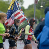 JIM VAIKNORAS/Staff photoMany runners carried flags and rucksacks in the Derek Hines Flag Day 5k at Cashman Park in Newburyport.