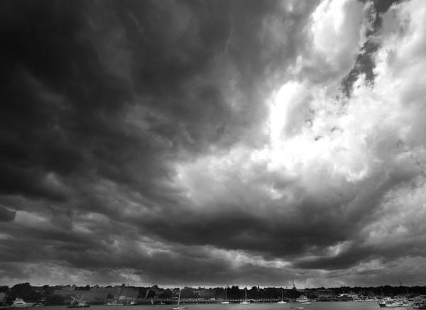 JIM VAIKNORAS/Staff photo Dark clouds move over the Merrimack River Sunday morning looking toward Newburyport from Salisbury.