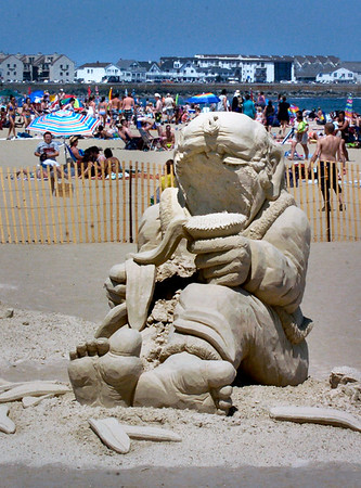 """BRYAN EATON/File Photo. Sand sculptor Justin Gordon of Groveland has his sand sculpture on display at the 16th Annual Hampton Beach Master Sand Sculpting Classic """"Under the Sea… Sand Sculpting Classic."""" His work, entitled """"She Loves Me"""" was one of the works of art vandalized."""