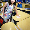BRYAN EATON/Staff photo. Alexa Warchol, 7, cleans her desk with other students in Julia Doyle's first grade class at the Bresnahan School as classes ended for summer vacation.