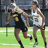 BRYAN EATON/Staff Photo. Newburyport's Margaret Cote takes the ball downfield.