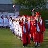 JIM VAIKNORAS/Staff photo Seniors march into Landry Stadium at the start of Amesbury high graduation Friday night.