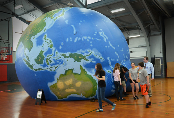BRYAN EATON/Staff Photo. Amesbury Middle School seventh-graders exit  EarthView a 20-foot high inflatable globe that helps students understand geography of the planet. The exhibit from Bridgewater State University, which gives student a virtual tour of the planet was at the middle school with the financial support from Salem State College.