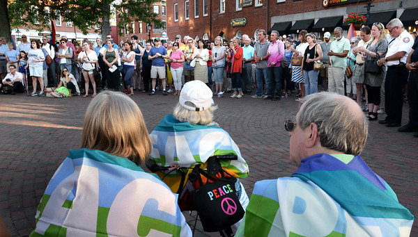 BRYAN EATON/Staff Photo. An estimated 300 people showed up in Newburyport's Market Square on Wednesday night for a vigil in support of those killed in the Pulse nightclub in Orlando, Florida on Sunday.