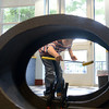 "JIM VAIKNORAS/Staff photo Lars Chapman, 6, of Salisbury navagates the loop da loop at one of the hole of mini golf at the Newburyport Library Saturday. The library was turned into a 18 hole course to kick off their summer reading program ""On Your Mark, Get Set, Read!,""."
