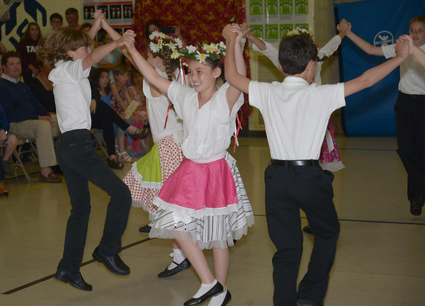 JIM VAIKNORAS/Staff photo Fourth graders dancer the Polka at the 4th grade Immigration Dance and Dinner at the Amesbury Elementary School. Choreographed by Christian Chadot, students also performed a Chinese Dragon Dance and an African Drum Dance. 52 4th graders practiced twice a week after school since April to learn the 3 dances.