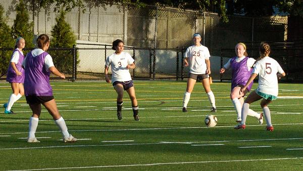 BRYAN EATON/Staff Photo. An alumni game of girl soccer players at Newburyport High School.