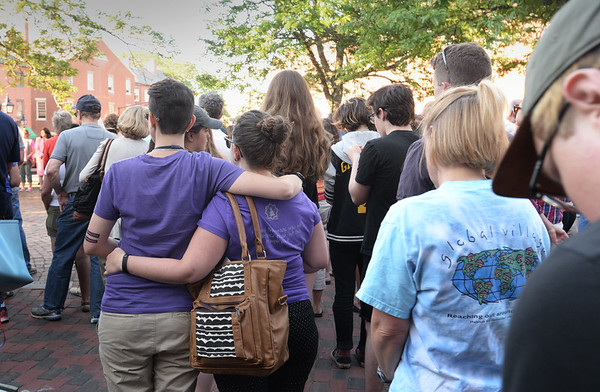 BRYAN EATON/Staff Photo. Attendees to a vigil Wednesday night in Market Square in Newburyport were silent as different members of local clergy read the names and ages killed in the nightclub massacre in Orlando, Florida.