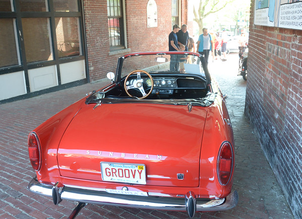 JIM VAIKNORAS/Staff photo 6/26/2016 A 1966 Sunbeam Alpine belonging to Doug Shealy of Rowley is looking for fun and feeling groovy at the Amesbury Days Car Show in downtown Amesbury Sunday.