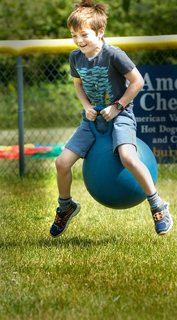 BRYAN EATON/Staff Photo. Ben Buchmayr, 7, bounces along in a relay race at the Cashman School in Amesbury on Tuesday morning. The school was having its annual Field Day events.
