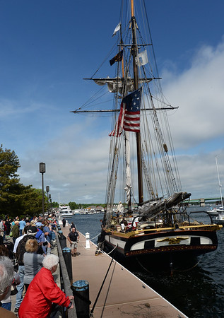 BRYAN EATON/Staff Photo. Scores of people showed up to watch the arrival of the Lynx. The privateer is a replica of the ship the British captured.