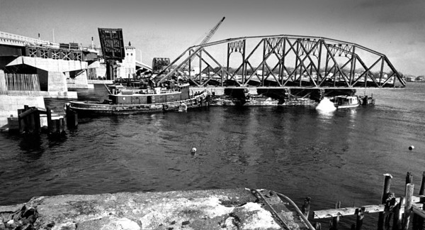 Daily News File Photo. With the southbound lane of Gillis Bridge completed and open to traffic both ways, the northbound lane is still under construction. The sections of the old bridge than spanned the Merrimack River between Newburyport and Salisbury, and built in 1902, were removed in December of 1975.