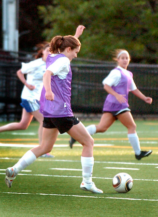 BRYAN EATON/Staff Photo. Carly Brand moves the ball downfield.