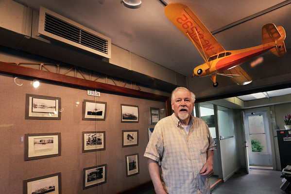 BRYAN EATON/Staff Photo. Charlie Eaton reflects on the long history of the  Plum Island Airfield standing in the small museum of artifacts, photos and news clippings.