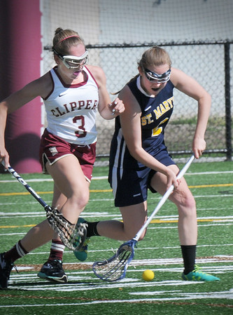 BRYAN EATON/Staff Photo. Newburyport's Olivia Katavolos chases a loose ball with a St. Mary's player.
