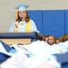 JIM VAIKNORAS/Staff photo Honor speaker valadictorian Olivia Less gives her address at Triton's Commencement Saturday in the school's field house.