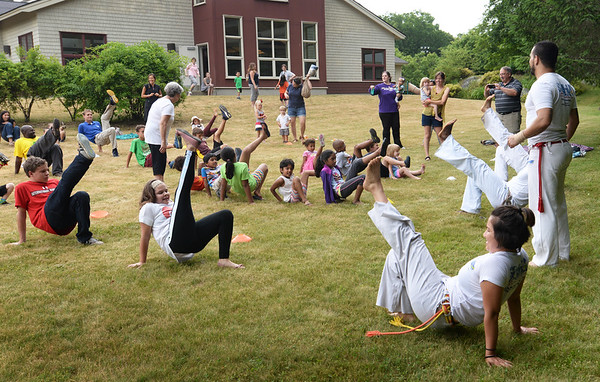 BRYAN EATON/Staff photo. Youngsters got to observe and participate in a martial arts and acrobatic demonstrations at the Newbury Public Library on Tuesday. It was the kickoff for the summer children's programs.