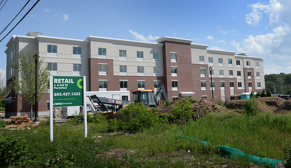 BRYAN EATON/Staff Photo. Hampton Inn and Suite by Hilton in Amesbury is to open at the end of summer and is advertising for positions.