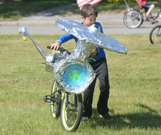 JIM VAIKNORAS/Staff photo 6/25/2016 Anthony Sorrento , 9, pays tribute to Star Trek with a USS Enterprise inspired bike during the bike parade Rowley 4th of July festival at Rowley Common Saturday morning.