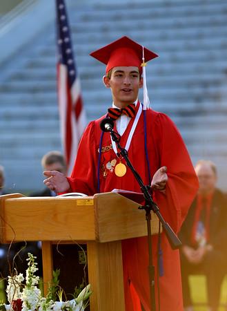 JIM VAIKNORAS/Staff photo Spencer Moavenzadeh gives the Salutatorian address at Amesbury high graduation at Landry Stadium Friday night.