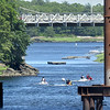 BRYAN EATON/Staff Photo. Jet skiers head down the Merrimack River under the Chain Bridge yesterday afternoon under a blue sky. The rest of the week is looking as good weatherwise.
