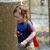 JIM VAIKNORAS/Staff photo Duke Yewell, 2, enjoys the Inn Street fountain at it's dedication Saturday. he was there with his brother Olson, 5, who was also dressed as Superman.