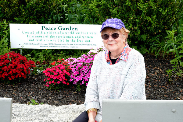 JIM VAIKNORAS/Staff photo  Getting aquainted with Joanna Hammond at the Peace garden along the waterfront in Newburyport.