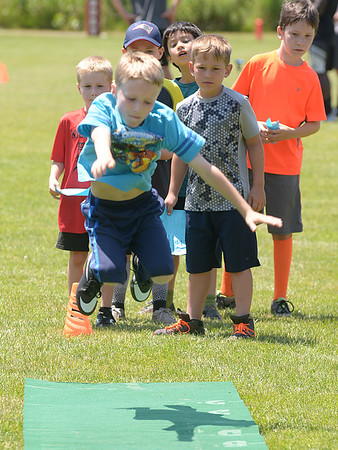 JIM VAIKNORAS/Staff photo 6/24/2016 Brodie Hall with the standing broad jump during a youth football combine at Landry Stadium in Amesbury.