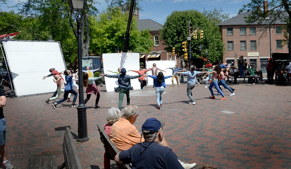 BRYAN EATON/Staff Photo. Dancers perform amid reflective sheets, cameras and spectators in Newburyport's Market Square on Tuesday. Turning many heads with people taking cellphone video, the filming was not a major motion picture but a commercial for the Connecticut State Lottery.