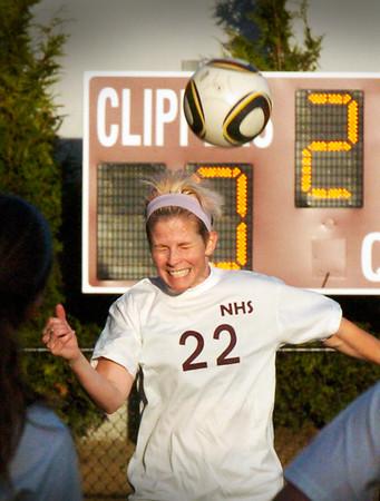 BRYAN EATON/Staff Photo. Melissa Donaldson heads the ball in the alumni game.